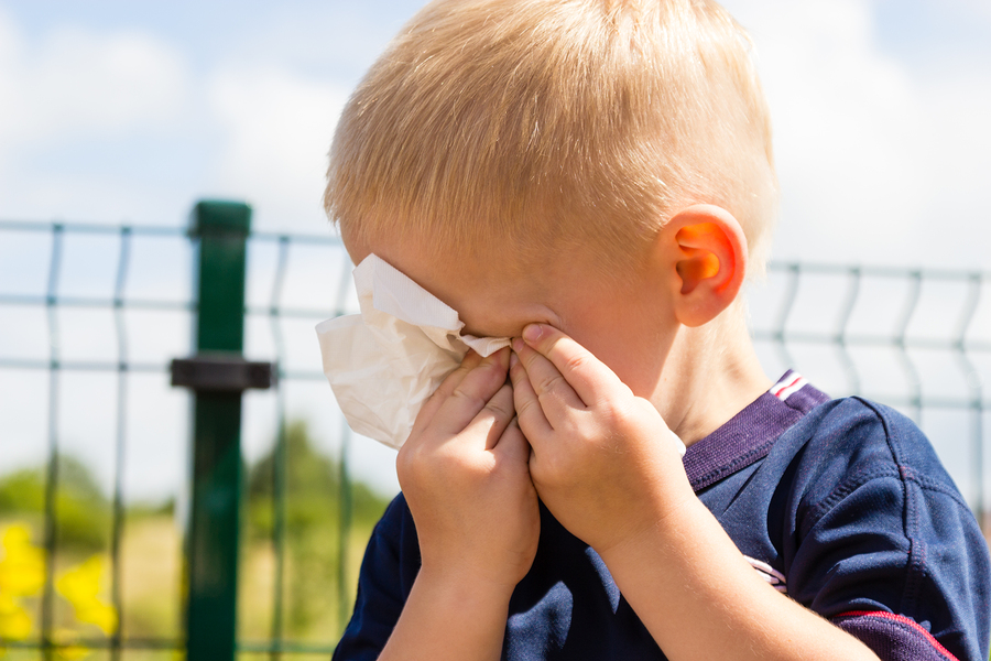 Emotions and feeling. Sad little boy crying unhappy child wiping his eyes with tissue outdoor
